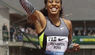 United States' Sanya Richards-Ross celebrates her win in the 400-meter event Saturday, June 2, 2012, at the Prefontaine Classic athletics meet in Eugene, Ore. (AP Photo/Ted S. Warren)