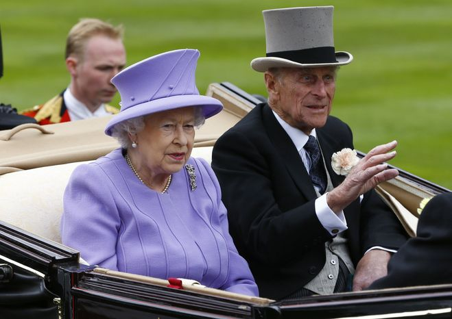 ** FILE ** Britain's Queen Elizabeth II and Prince Philip arrive by carriage in the parade ring on the fourth day of the Royal Ascot horse race meeting at Ascot, England, on Friday, June 22, 2012. (AP Photo/Alastair Grant)