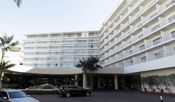 ** FILE ** This Feb. 17, 2012, photo shows a general view of the Beverly Hilton Hotel in Beverly Hills, Calif. Police say two people have been found dead in what investigators believe was a murder-suicide in a room shooting at the Beverly Hilton, just hours before the Daytime Emmy Awards are being held at the posh hotel. (AP Photo/Matt Sayles)