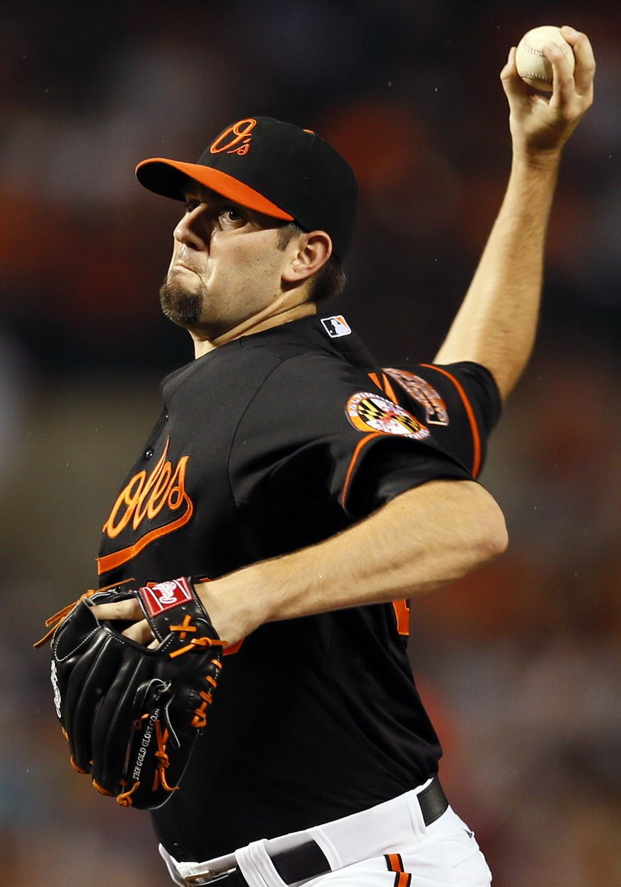 Starting pitcher Jason Hammel gave up one run in eight innings and struck out 10 as the Baltimore Orioles defeated the Washington Nationals 2-1 on Friday night. (AP Photo/Patrick Semansky)