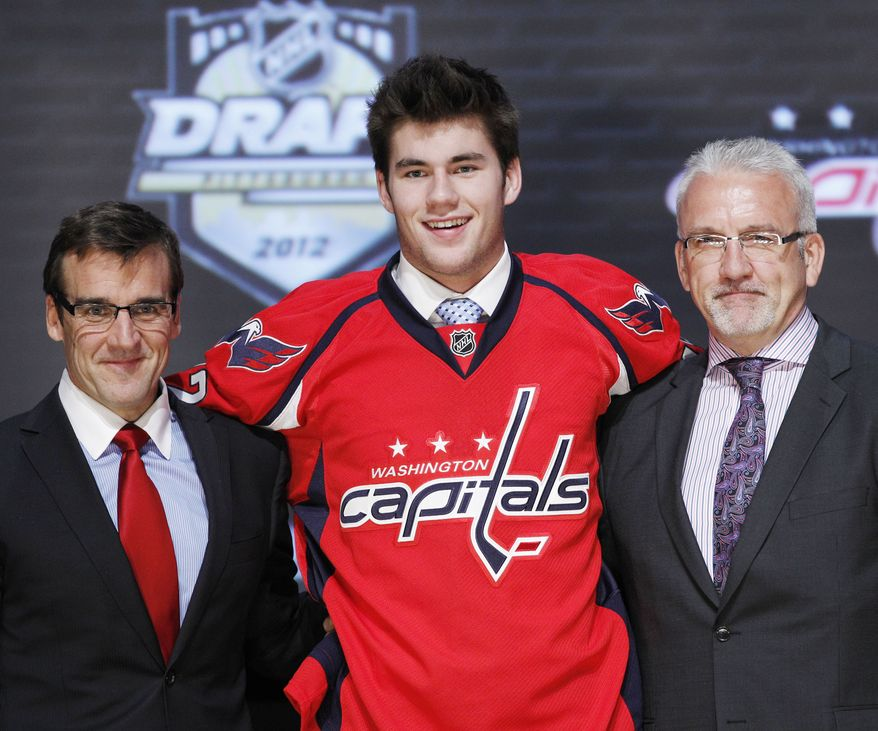 Winger Tom Wilson stands with Washington Capitals officials after being chosen 16th overall in the first round of the NHL draft on Friday, June 22, 2012, in Pittsburgh. (AP Photo/Keith Srakocic)