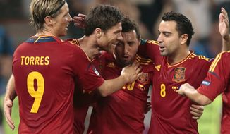 Spain's Xabi Alonso, second left, celebrates with teammates after scoring on a penalty kick his side's second goal during the Euro 2012 soccer championship quarterfinal match between Spain and France in Donetsk, Ukraine, on Saturday, June 23, 2012. (AP Photo/Ivan Sekretarev)