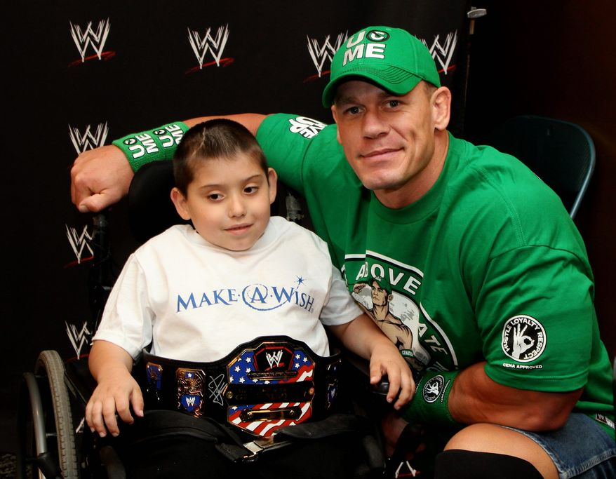 Jonny Littman received a wish from WWE superstar John Cena that was extra special. It was the 300th time the wrestler helped someone through the Make-A-Wish Foundation. (Associated Press)