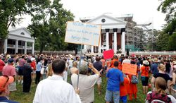 Students and faculty members held a Rally for Honor on the University of Virginia campus Sunday to urge the reinstatement of Teresa A. Sullivan as the university's president. Ms. Sullivan resigned June 10 under pressure from the university's governing board. (Associated Press)