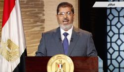 In this image from Egyptian state TV, President-elect Mohammed Morsi delivers a speech in Cairo on Sunday. President Obama called to congratulate him and underscored that the United States will continue to support Egypt's transition to democracy. (Associated Press)