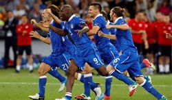 Italian players begin to celebrate after defeating England in the Euro 2012 quarterfinals in Kiev, Ukraine. Next up is a match with Germany on Thursday in Warsaw, Poland. The match was scoreless after 120 minutes of play. (Associated Press)