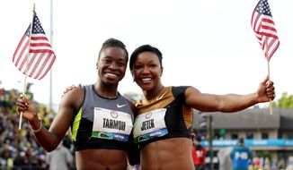 Jeneba Tarmoh (right), shown with Carmelita Jeter, finished in a dead heat with Allyson Felix in the 100 at the U.S. trials on Saturday. Tarmoh and Felix will be competing for spots in the 200 meters starting Thursday. (Associated Press)