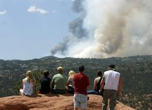Smoke billows from a wildfire west of Colorado Springs, Colo., on Saturday, June 23, 2012. (AP Photo/Bryan Oller)