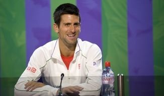 In this photo released by the AELTC, Novak Djokovic of Serbia speaks during a press conference at the All England Lawn Tennis Championships, Wimbledon, England, Sunday, June 24, 2012. (AP Photo/AELTC, Neil Tingle)