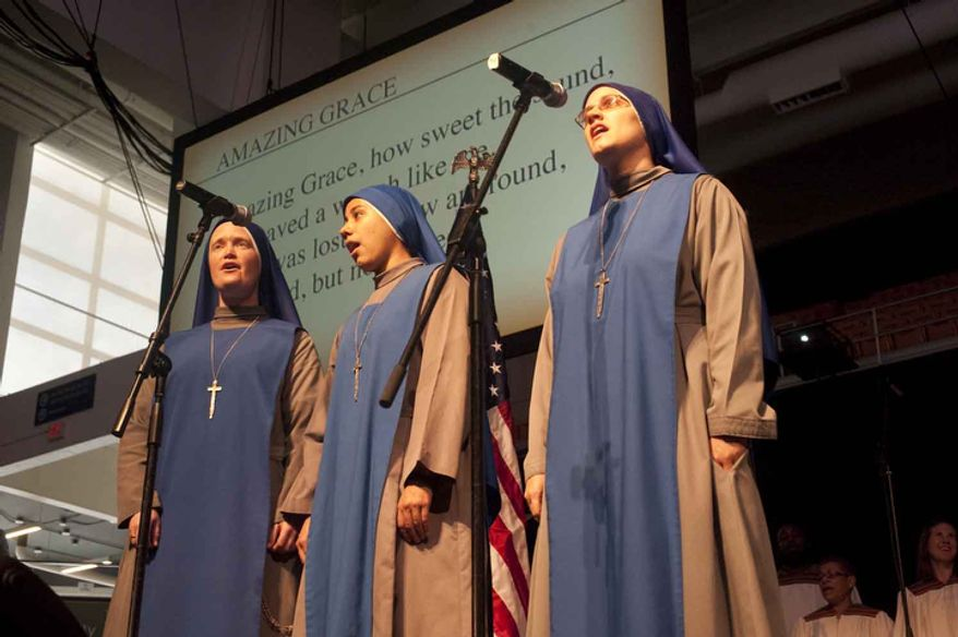 "Nuns of the Sister Servants of Our Lord and Our Lady of Matara sing ""Amazing Grace"" in English and Spanish during the Fortnight for Freedom event at George Washington University in Washington, D.C. Sunday, June 24, 2012. (Raymond Thompson/The Washington Times)"