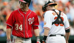 Washington Nationals' Bryce Harper walks off the field after striking out swinging in the eighth inning of an interleague baseball game against the Baltimore Orioles in Baltimore, Sunday, June 24, 2012. Baltimore won 2-1. (AP Photo/Patrick Semansky)