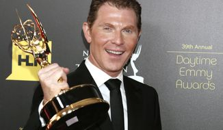 "Cooking show host Bobby Flay poses backstage with the Emmy for best culinary program for his ""Barbecue Addiction"" at the 39th Annual Daytime Emmy Awards at the Beverly Hilton Hotel on Saturday, June 23, 2012, in Beverly Hills, Calif. (AP Photo/Todd Williamson, Invision)"