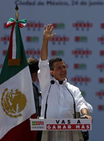 Enrique Pena Nieto, Revolutionary Institutional Party (PRI) presidential candidate, speaks June 24, 2012 during a massive rally at the Azteca stadium in Mexico City. (Associated Press)