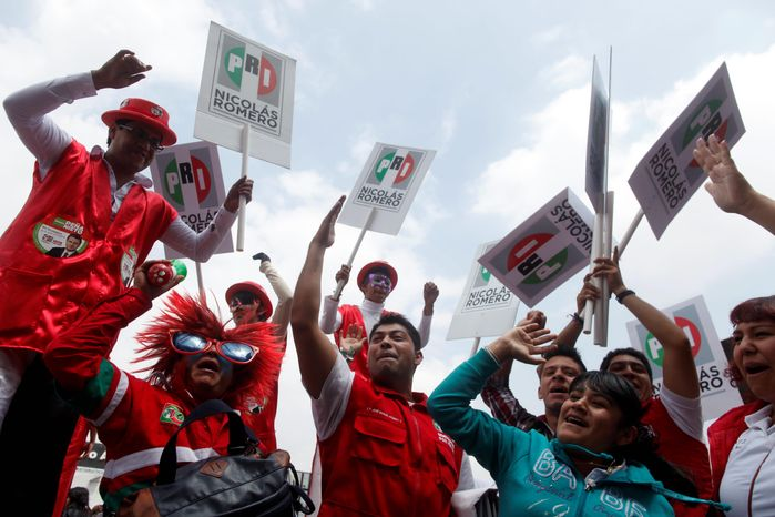 Supporters of Enrique Pena Nieto, presidential candidate of the opposition Institutional Revolutionary Party, PRI, cheer during a campaign rally at the Azteca stadium in Mexic