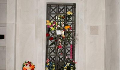 Elvis Presley's crypt in the Forest Hill Cemetery in Memphis, Tenn., was pulled from an auction due to fan outcry. (Associated Press)