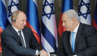 Russian President Vladimir Putin spent Monday in Jerusalem for talks with Israeli Prime Minister Benjamin Netanyahu. During their meeting at the Israeli leader's residence, they discussed concerns about Iran's nuclear program, with Mr. Netanyahu urging Russia to increase pressure on Iran to curb its activity, and Mr. Putin giving no sign of concessions on the subject. (Ria-Novosti via Associated Press)