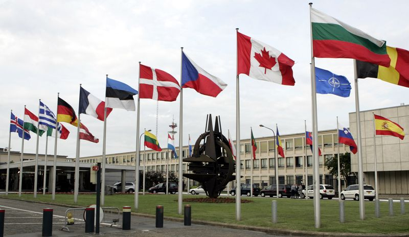 The flags of NATO member countries fly outside the alliance's headquarters in Brussels in June 2007. (AP Photo/Virginia Mayo)