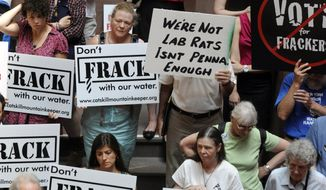 "**FILE** Protesters rally June 20, 2012, against hydrofracking as the legislative session winds down at the Capitol in Albany, N.Y. A coalition of 100 environmental, health and community groups called for Gov. Andrew Cuomo to reject any demonstration project for shale gas drilling using hydraulic fracturing, or ""fracking."" (Associated Press)"