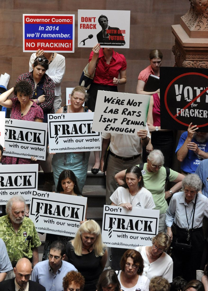 """**FILE** Protesters rally June 20, 2012, against hydrofracking as the legislative session winds down at the Capitol in Albany, N.Y. A coalition of 100 environmental, health and community groups called for Gov. Andrew Cuomo to reject any demonstration project for shale gas drilling using hydraulic fracturing, or """"fracking."""" (Associated Press)"""