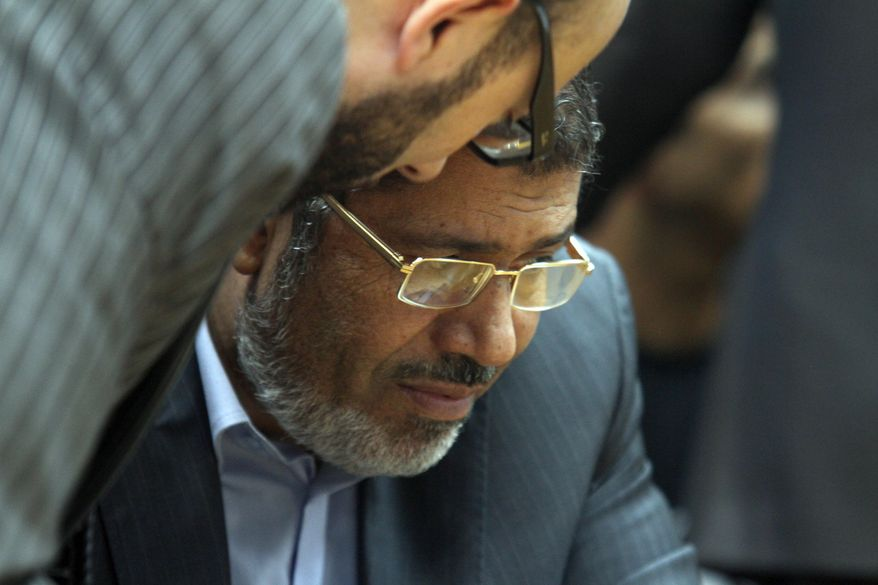 ** FILE ** Then-Egyptian presidential candidate Mohammed Morsi confers with an aide on Sunday, June 3, 2012. (AP Photo/Ahmed Gomaa)