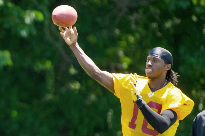 Quarterback Robert Griffin III, the Heisman Trophy winner last season at Baylor, was taken by the Redskins with the second overall pick in April after Washington made a blockbuster trade with St. Louis. (Andrew Harnik/The Washington Times)