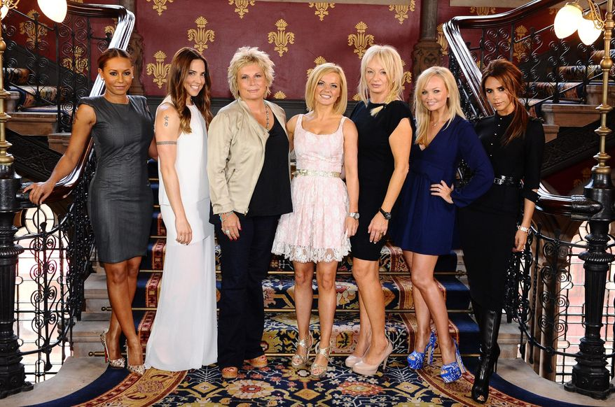 Scriptwriter Jennifer Saunders (third from left) and producer Judy Craymer (third from right) with Spice Girls (from the left) Melanie Brown, Melanie Chisholm, Geri Halliwell, Emma Bunton and Victoria Beckham