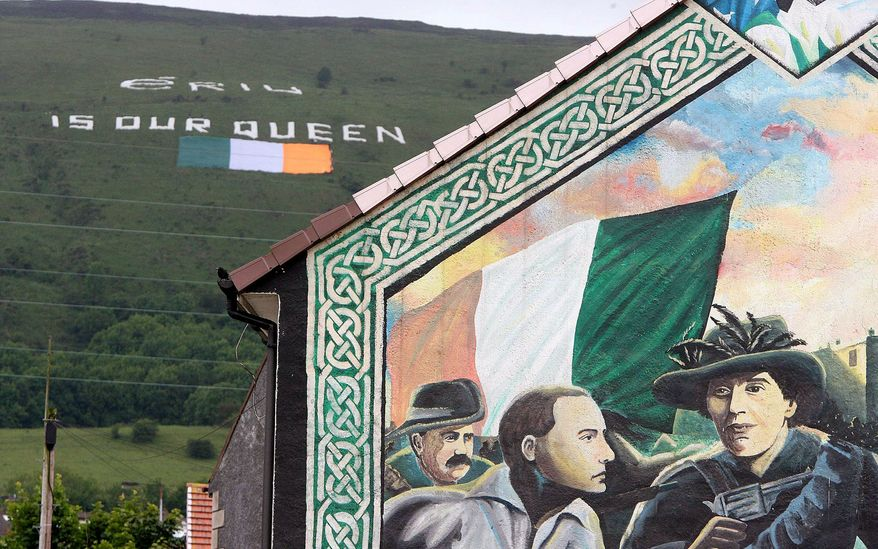 "Supporters of small IRA groups that still mount occasional attacks have denounced Mr. McGuinness' party Sinn Fein as ""sellouts."" Overnight before Queen Elizabeth's arrival, a hillside overlooking Catholic West Belfast was decorated with a massive Irish flag and the slogan ""Erin is our Queen."" (Associated Press)"