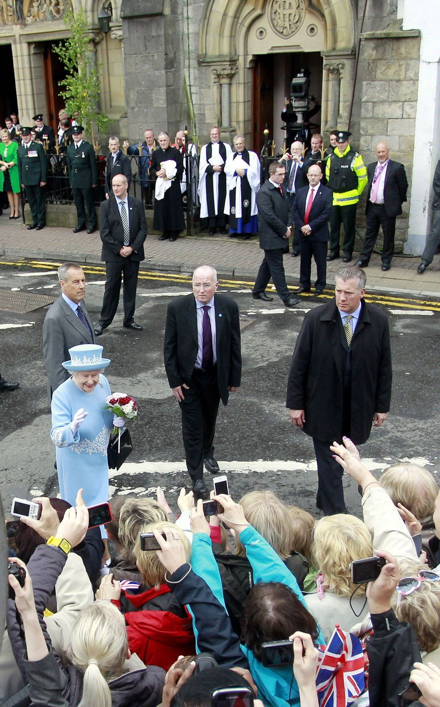 Britain's Queen Elizabeth II greets well-wishers Tuesday as she leaves St. Michael's Roman Catholic Church in Enniskillen, Northern Ireland. Her two-day visit marking her Diamond Jubilee is scheduled to include a meeting with former IRA leader Martin McGuinness for what many view as the symbolic conclusion to a decades-long conflict with the crown. (Associated Press)