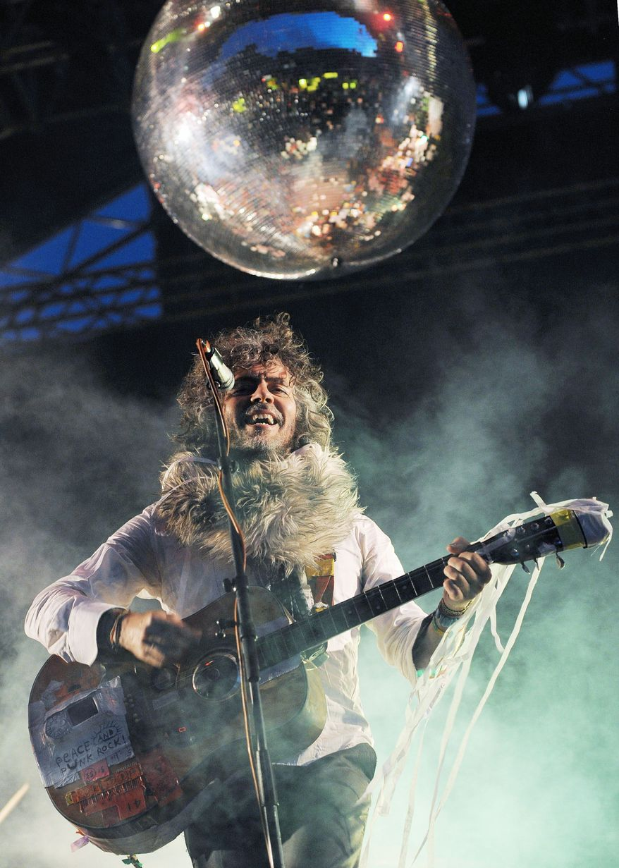 ** FILE ** This June 8, 2012, file photo shows Wayne Coyne, the lead singer and guitarist of American band The Flaming Lips during the Optimus Primavera Sound music festival in Porto, Portugal. (AP Photo/Paulo Duarte)