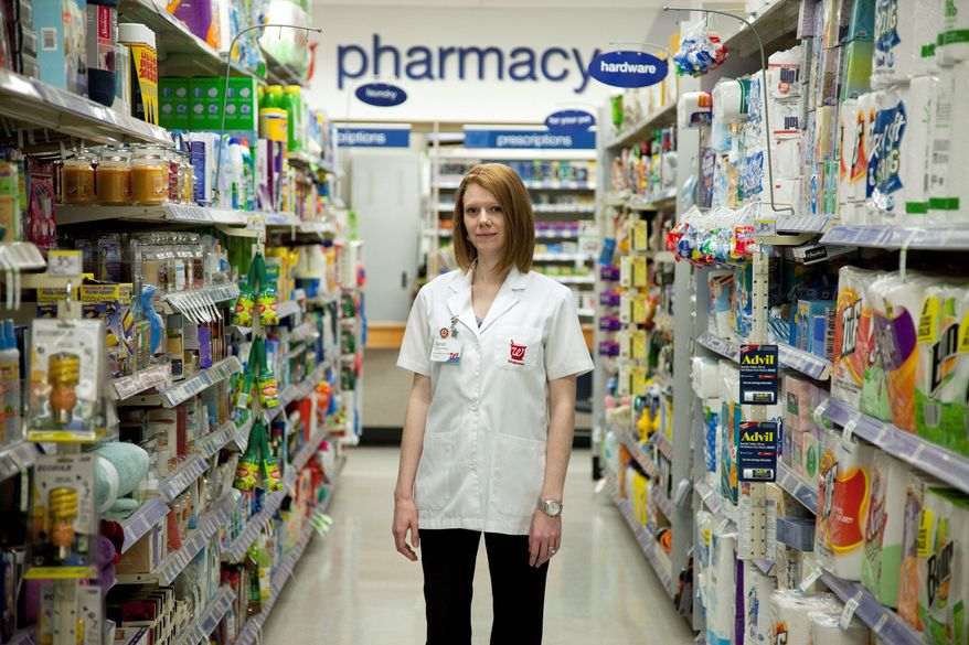 """""""I'm excited. It's such a new and novel thing for us,"""" said Sarah Freedman, who manages a Walgreens in Washington, D.C., that is participating in the pilot program. At her pharmacy, the testing is done in a private room. They've also taken steps to make sure that a customer can very quietly request the test. (Associated Press)"""