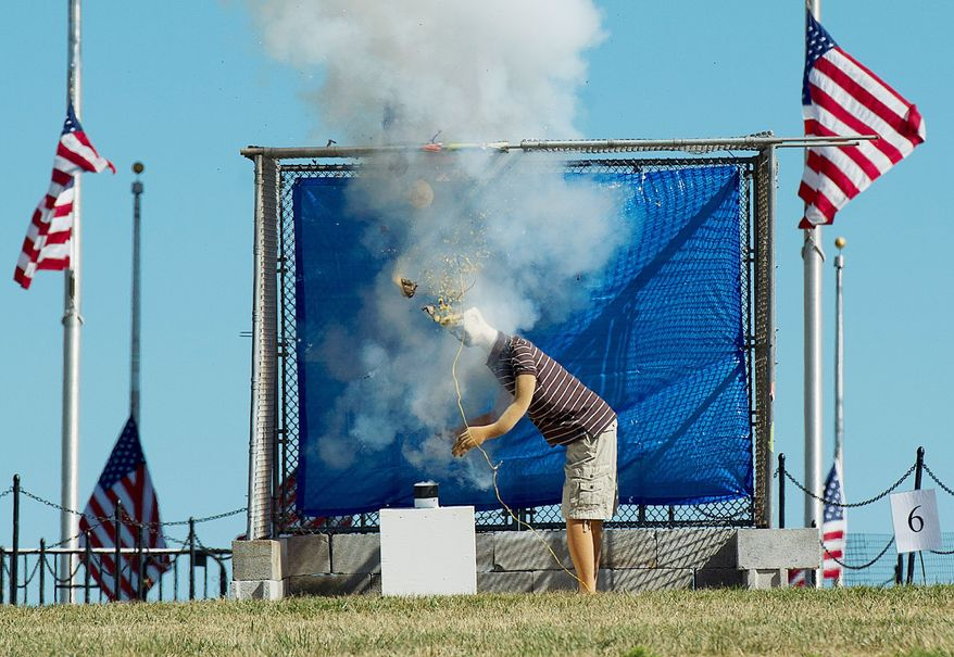 A mannequin is positioned with its head over the tube of a firework to illustrate what not to do after lighting a firework. The U.S. Consumer Product Safety Commission held a safety demonstration on Tuesday on the grounds of the Washington Monument to illustrate the perils. (Barbara L. Salisbury/The Washington Times)