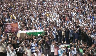 This citizen journalism image provided by Shaam News Network SNN, purports to show anti-Syrian regime mourners raising their hands and chanting slogans, as they carry the coffins of Syrian citizens who were killed by the Syrian forces shelling, in Daraa, southern Syria, Tuesday June 26, 2012. Syria's elite Republican Guard forces clashed with rebels just outside Damascus Tuesday in some of the most intense fighting involving the special forces guarding the capital since an uprising against President Bashar Assad's regime began last year, activists said. (AP Photo/Shaam News Network, SNN)