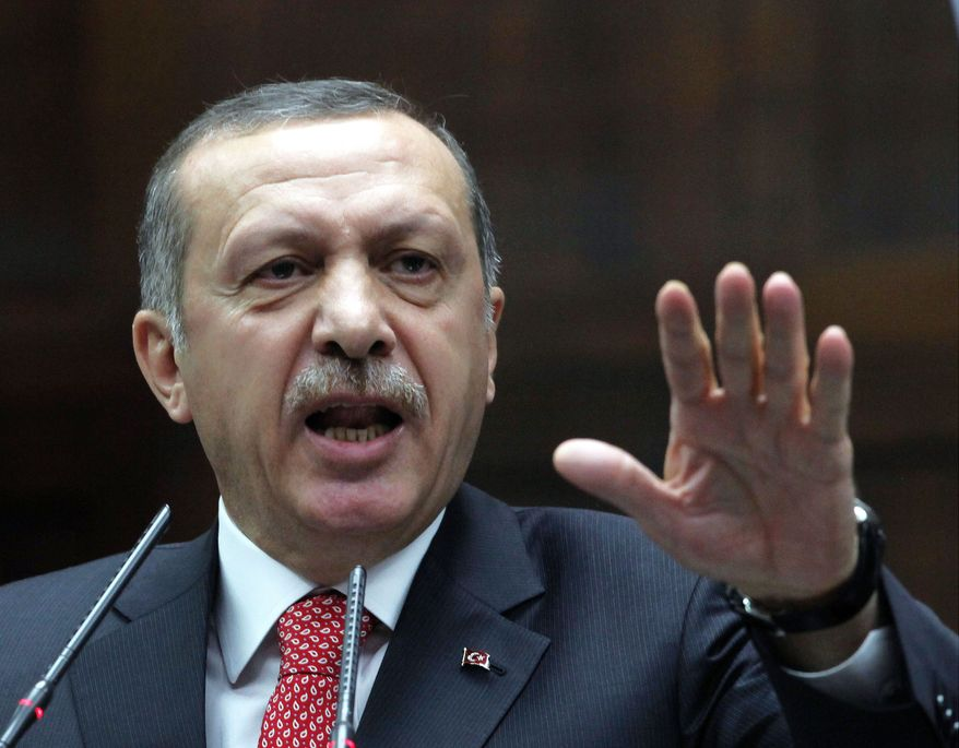 Turkish Prime Minister Recep Tayyip Erdogan, in a televised address Tuesday, stressed that his nation would not accept any encroachments or attacks by Syrian forces. (Associated Press)