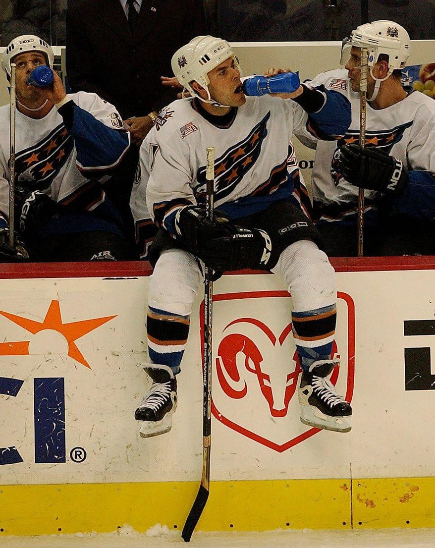 Washington Capitals C Adam Oates (77) takes a drink during a timeout in game action against the Toronto Maple Leafs in 3rd period action at the MCI Center in Washington, DC on Monday night, March 4, 2002, a 3-2 Caps loss.  ( Ross D. Franklin / The Washington Times )