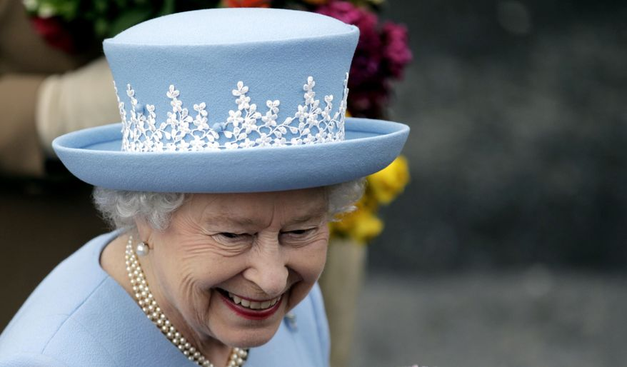 Britain's Queen Elizabeth II leaves a service of thanksgiving in Saint Macartin's Cathedral in Enniskillen, Northern Ireland, on Tuesday, June 26, 2012. The queen and her husband, the Duke of Edinburgh, are on a two-day visit to Northern Ireland to mark her 60 years on the throne. (AP Photo/Peter Morrison)