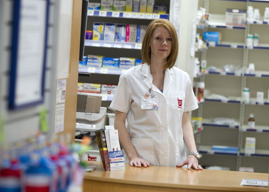 Walgreen's pharmacy manager Sarah Freedman stands June 26, 2012, in her store in Washington. The Centers for Disease Control and Prevention on Tuesday announced a $1.2 million pilot project to offer free rapid HIV tests at pharmacies and clinics in 24 cities and rural communities. (Associated Press)