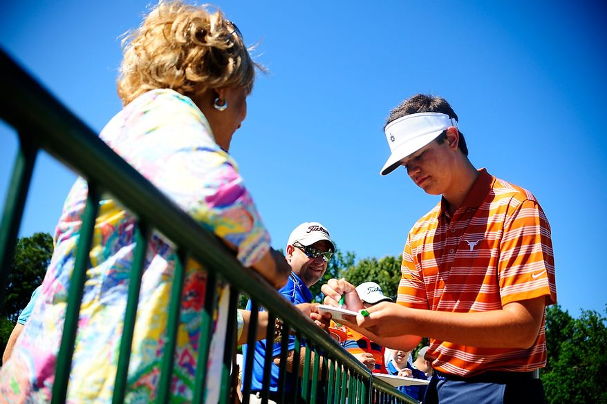 Beau Hossler signs autographs for fans at Congressional Country Club during the AT&T National on Tuesday, June 26, 2012.  (Ryan M.L. Young/The Washington Times)