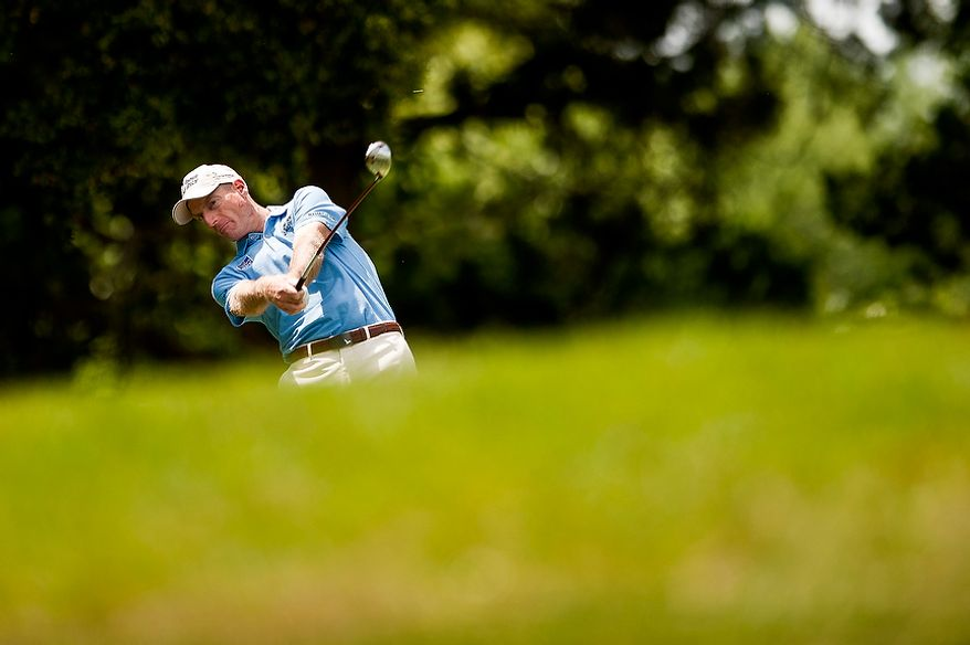 Jim Furyk tees off during a practice round at Congressional Country Club before the AT&T National golf tournament, Bethesda, Md., Tuesday, June 26, 2012.  The tournament will begin on Thursday and runs until Sunday.  (Ryan M.L. Young/The Washington Times)