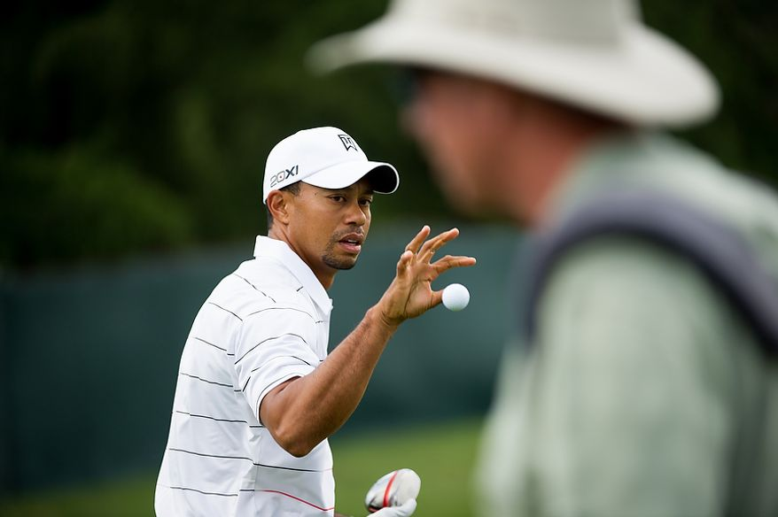 Tiger Woods takes practice on the driving range before the start of the AT&T National golf tournament held at Congressional Country Club, Bethesda, Md., Tuesday, June 26, 2012. The tournament will begin on Thursday and run until Sunday. (Andrew Harnik/The Washington Times)