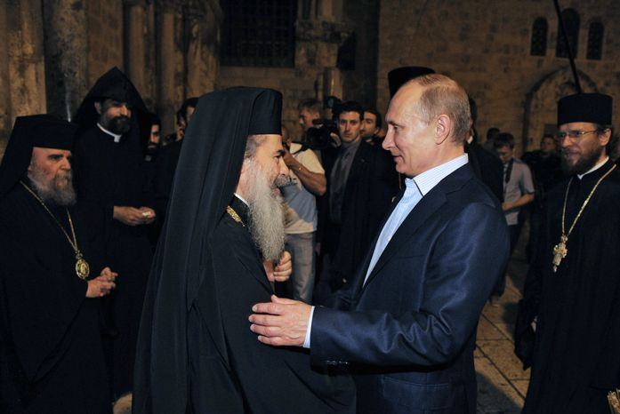 Theophilos III (left), patriarch of Jerusalem, welcomes Russian President Vladimir Putin to the Church of the Holy Sepulchre in Jerusalem on Tuesday, June 26, 2012. (AP Photo/RIA-Novosti, Alexei Druzhinin, Presidential Press Service)
