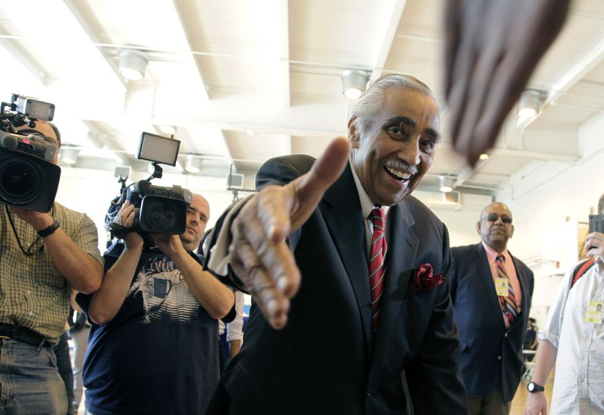 ** FILE ** Rep. Charles Rangel, New York Democrat, shakes hands with a poll worker June 26, 2012, as he arrives to vote in the Democratic primary in New York. (Associated Press)