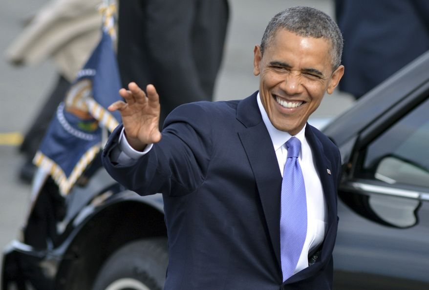 President Obama waves to supporters June 25, 2012, after arriving on Air Force One at Logan International Airport in Boston. (Associated Press)