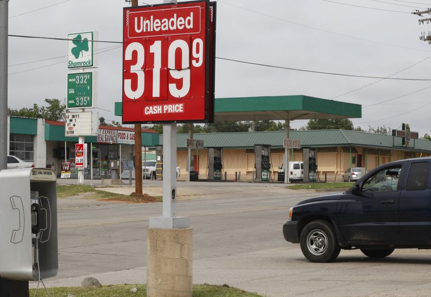 Competing gasoline stations advertise gas at 3.199 and 3.323 per gallon in Oklahoma City on June 21, 2012. (Associated Press)
