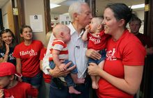 U.S. Sen. Orrin Hatch, R-Utah, holds his 3-month-old great grandson, Beckham Wilson, as he greets his great granddaughter, 8-month-old Maggie Jennings, and her mother, Callie Jennings, after arriving at his campaign headquarters to thank his volunteers and staff, Tuesday, June 26, 2012, in Salt Lake City. (AP Photo/Colin E. Braley)