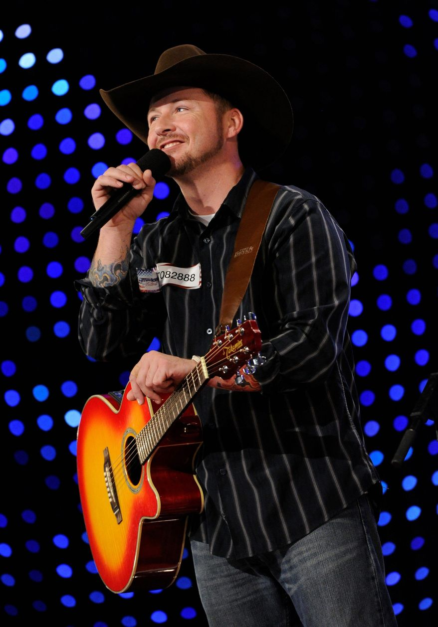 """Timothy Michael Poe performs on """"America's Got Talent."""" The singing soldier won't be advancing. (Associated Press)"""