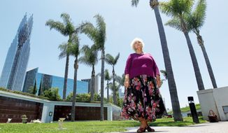 ASSOCIATED PRESS Dolores Rommel was a member of the Crystal Cathedral for years. Her husband is buried in a vault on church grounds and she will be buried there as well. Neither expected the church and cemetery would be sold to the Catholic Church.