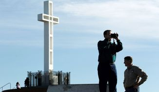 ** FILE ** In this June, 27, 2012, file photo, supporters of a war memorial cross at the Mount Soledad Veterans Memorial in San Diego are not giving up in their fight to keep the 58-year-old monument right where it is in the face of an adverse ruling from a federal appeals court. (Associated Press)