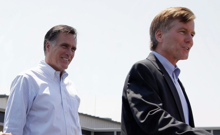 Republican presidential candidate Mitt Romney (left) listens in May as Virginia Gov. Bob McDonnell speaks on his behalf in Portsmouth, Va. Mr. McDonnell recently hinted that he is being vetted as a possible running mate on the GOP ticket. Previously, he had denied that he was under consideration for the vice-presidential spot. (Associated Press)