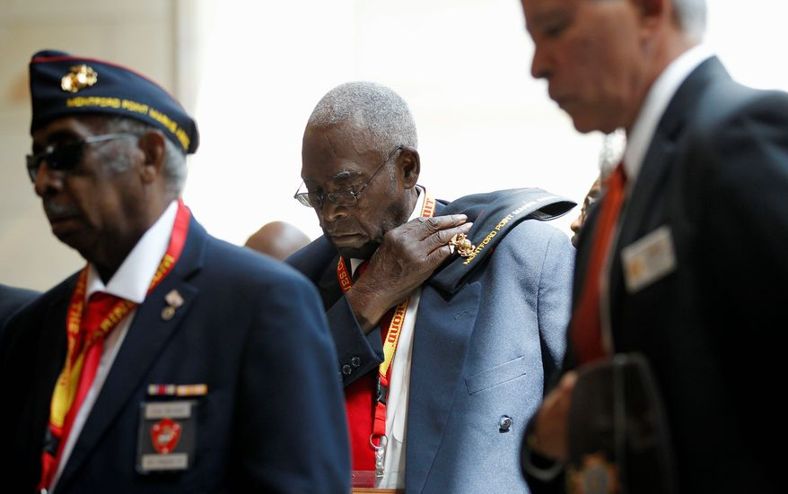 Henry Rayner (center) of Dudley, N.C., was among about 400 black veterans awarded the Congressional Gold Medal on Wednesday on Capitol Hill for helping integrate the Marine Corps during World War II. (Associated Press)