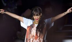 Singer Rihanna performs June 24, 2012, at the Radio One Hackney Music Festival in London. (Associated Press)